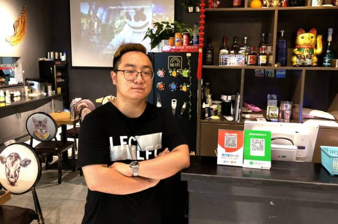Xing Zipeng, 24, offers both Alipay and WeChat Pay at his hotpot restaurant in Hangzhou.