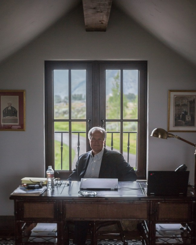 William Voge sat at a desk Thursday at his house in Jackson, Wyo.