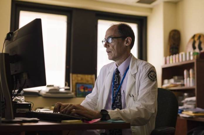 VA oncologist Michael Kelley working with Watson for Genomics on July 26.