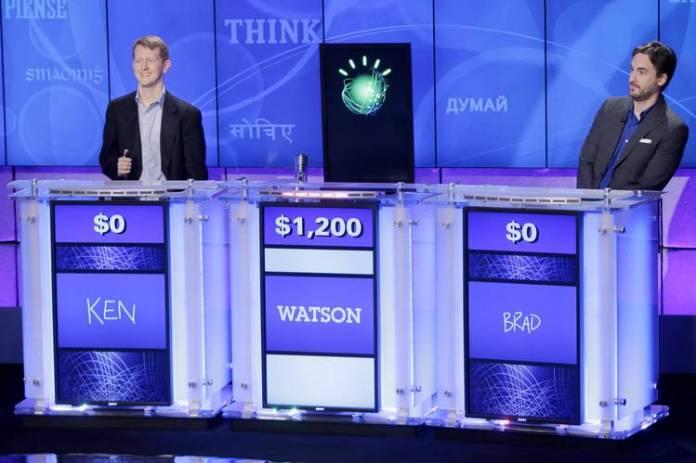 'Jeopardy!' champions Ken Jennings, left, and Brad Rutter, right, playing Watson on Jan. 13, 2011.