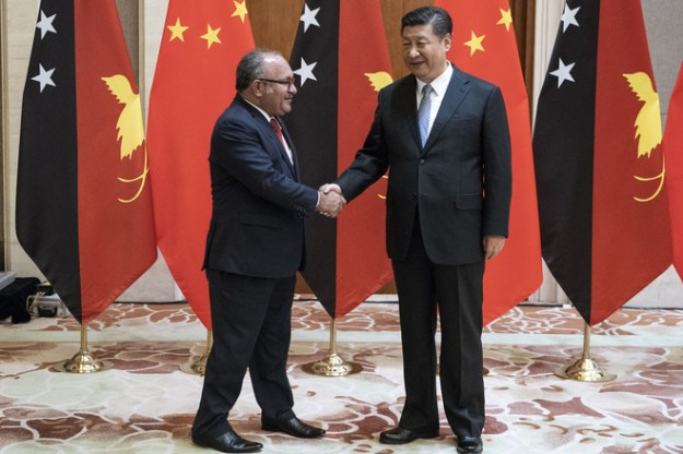 Papua New Guinea Prime Minister Peter O'Neill meeting with China's President Xi Jinping in Beijing on June 21. Almost a quarter of the country's debt is owed to the state-owned Export-Import Bank of China.