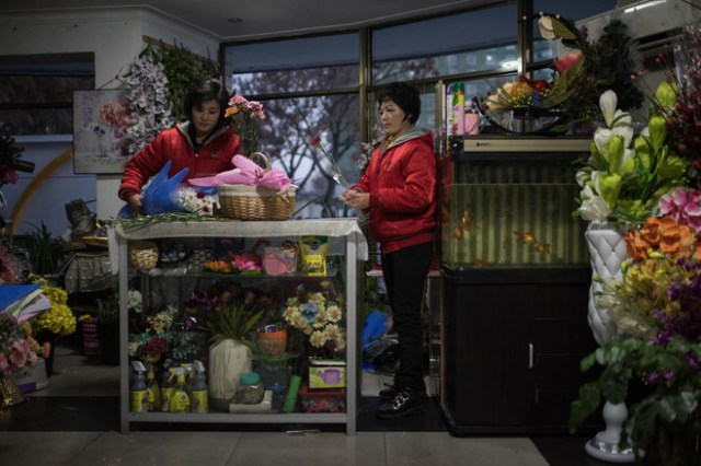 Vendors prepare flowers at a shop in Pyongyang in November.
