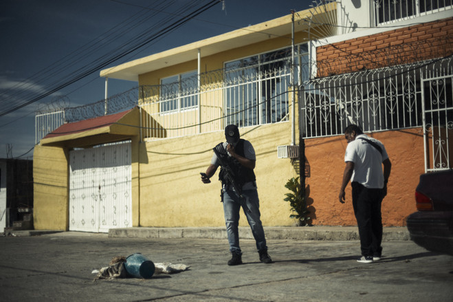 Mexican soldiers and police guard a severed head which was left as a message between rival drug cartels.  Latin America Is the Murder Capital of the World B3 BU525 0917la H 20180917231928