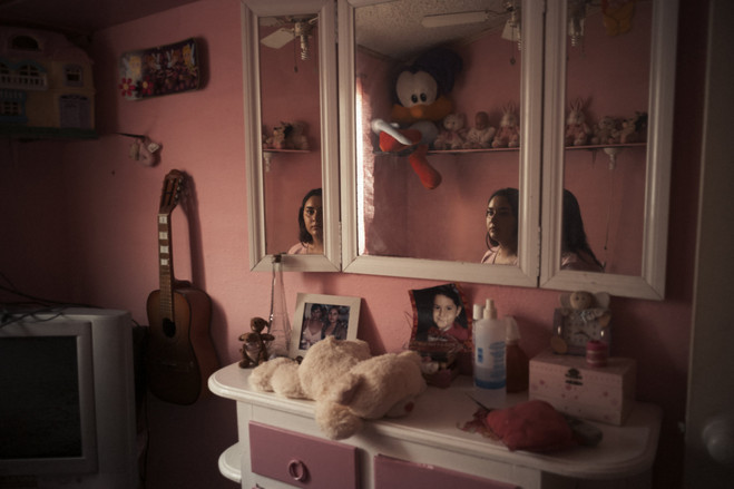 Lesly Mariana Reyes sits on her mother Penelope's childhood bed on a visit to see her grandmother. Penelope disappeared without a trace after a shift at her work as a manager of a local bank.  Latin America Is the Murder Capital of the World B3 BU536 0917la H 20180917231936