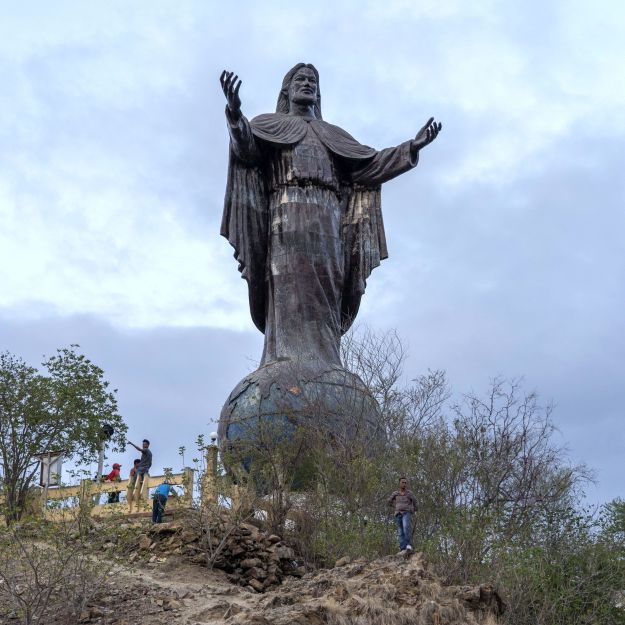 Officials say a plan to build a huge refinery complex is crucial to the long-term economic survival of East Timor's 1.3 million people. Above, a statue that is a popular tourist attraction in the country.
