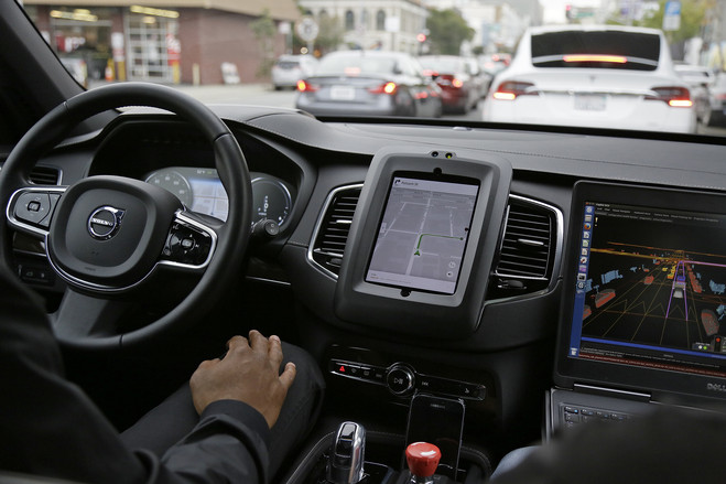 An Uber car in driverless mode waits in traffic during a test drive in San Francisco in December 2016.