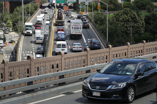 Traffic moves along the Brooklyn-Queens Expressway in New York. More people are moving to large, congested cities, and technology is giving them more options for getting around without owning a car.