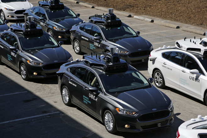Self-driving Uber vehicles at a 2016 media preview at Uber's Advanced Technologies Center in Pittsburgh.