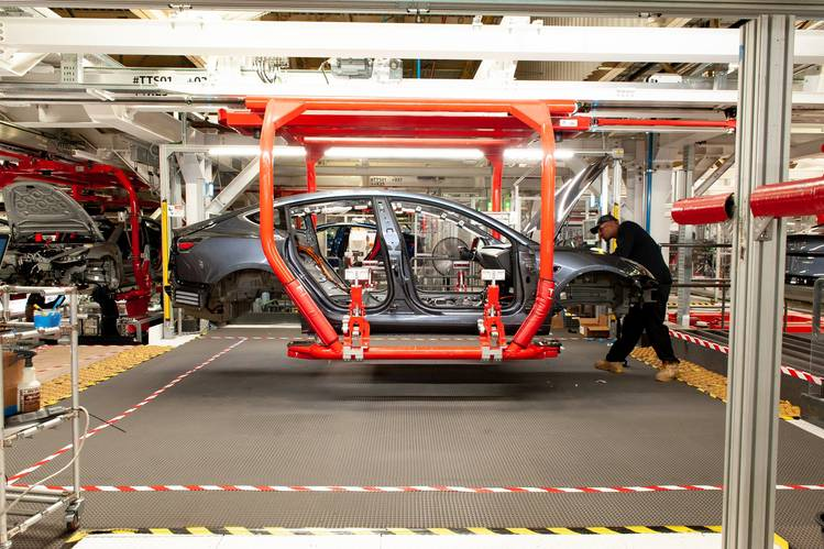 A worker on the Model 3 assembly line at Tesla's Fremont, Calif., factory on June 11.   Your Smartphone's Location Data Is Worth Big Money to Wall Street B3 CG169 THASOS P 20181101165453