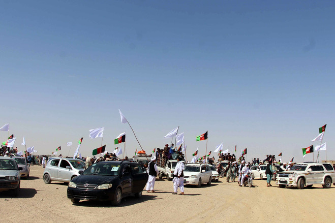 A group of Taliban fighters visited areas controlled by the Afghan government to greet people during a three-day ceasefire in June.