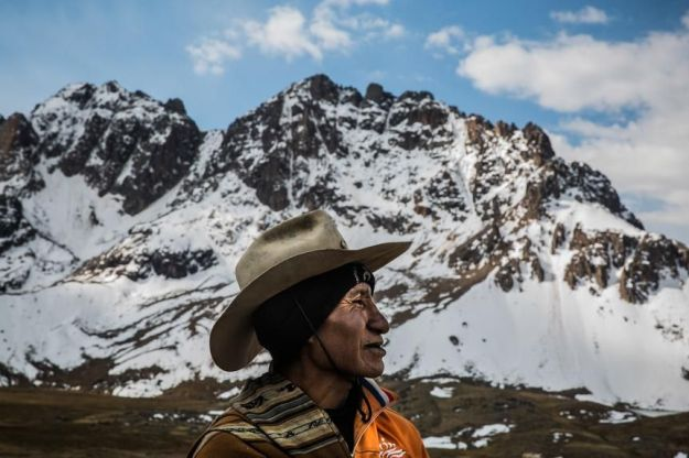 Portrait of alpaca herdsman while talking to Armando Tinta, a local travel guide, at the Jahuaycate pass.