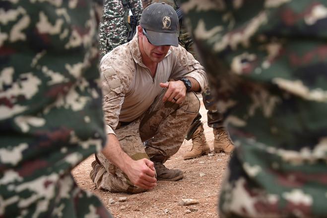 A U.S. Marine Raider works with commandos.