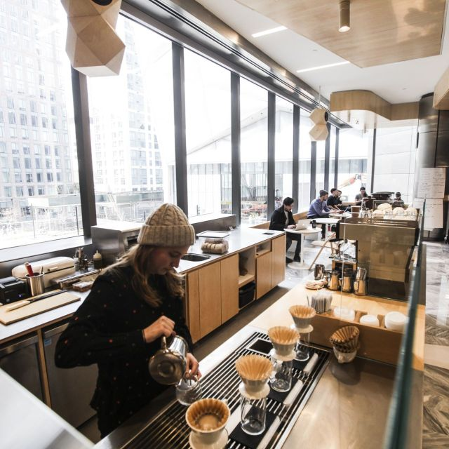 An employee of the Blue Bottle coffee shop trains on Wednesday before the retail complex opens at 20 Hudson Yards on Friday.