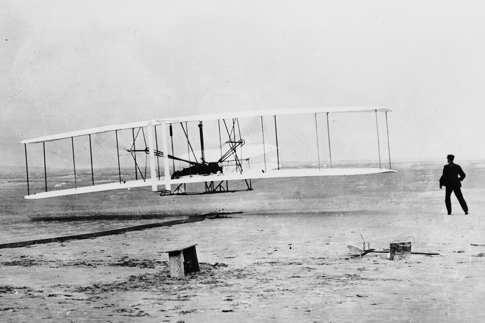 Orville Wright flying a Wright glider near Kitty Hawk, N.C. The Wright Brothers saw an analogy to the machine that they already designed, manufactured and repaired for a living—the bicycle.