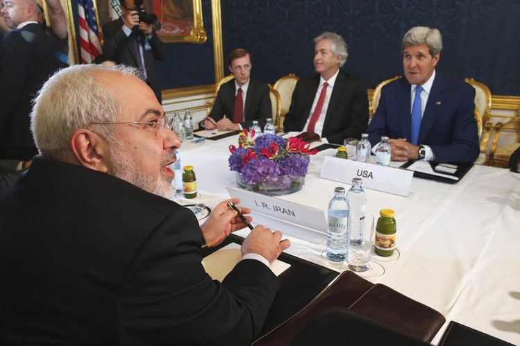 Iran's Foreign Minister Javad Zarif, foreground left, met with U.S. Secretary of State John Kerry, background right, in Vienna in July.
