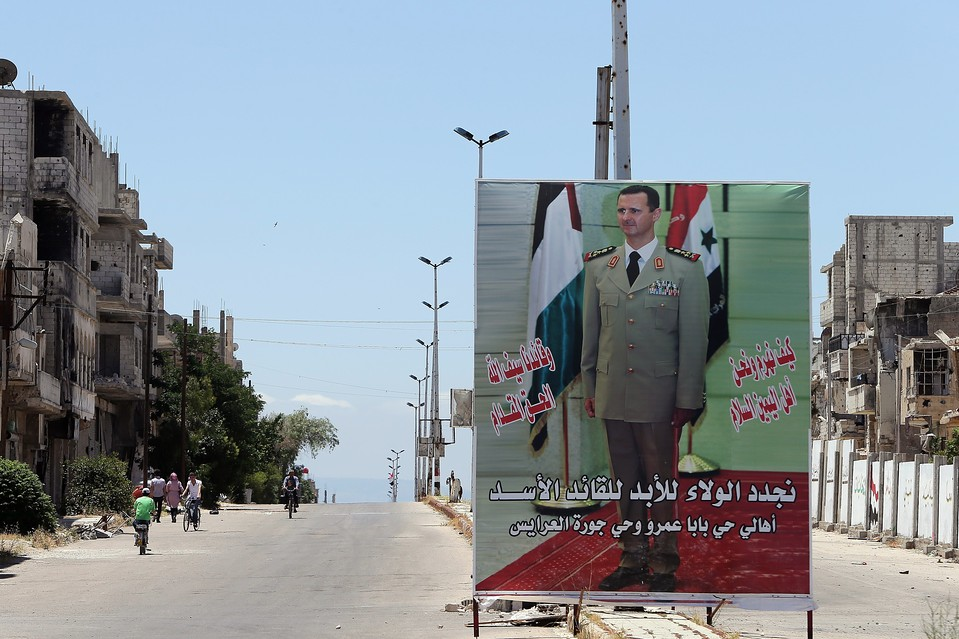A poster of Syrian President Bashar al-Assad in the city of Homs, where the early confrontations between protesters and regime authorities progressed into civil war.