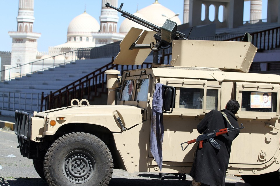 A Houthi fighter with a military vehicle seized from the army, outside  the presidential palace in San'a on Thursday.