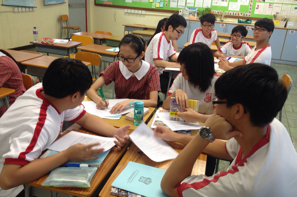 Students take part in small group discussions in a liberal studies class in Hong Kong.