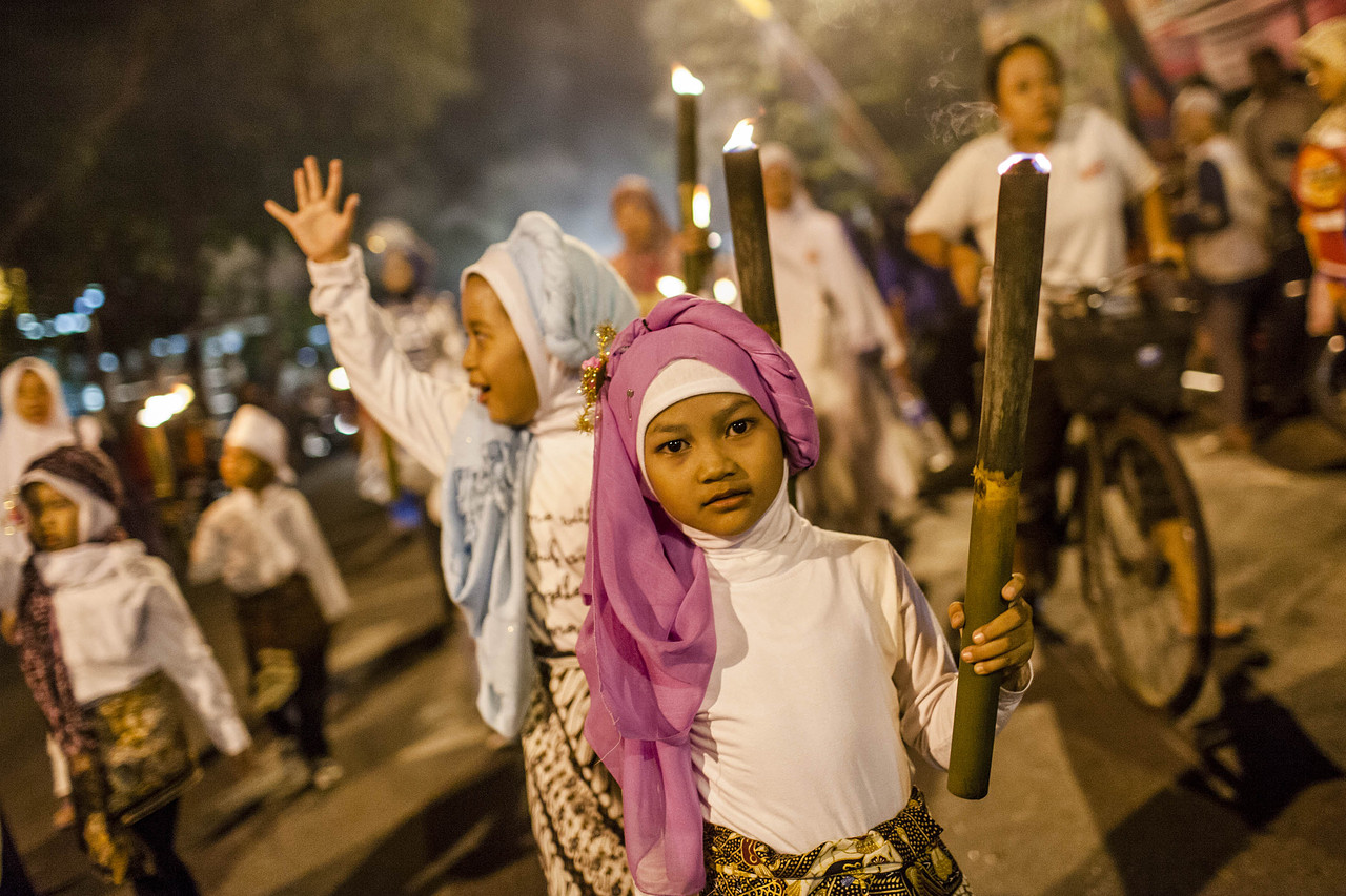 Muslim children carry torches during a parade before Eid al-Fitr, at the end of the holy month of Ramadan, on July 27, 2014, in Yogyakarta, Indonesia.