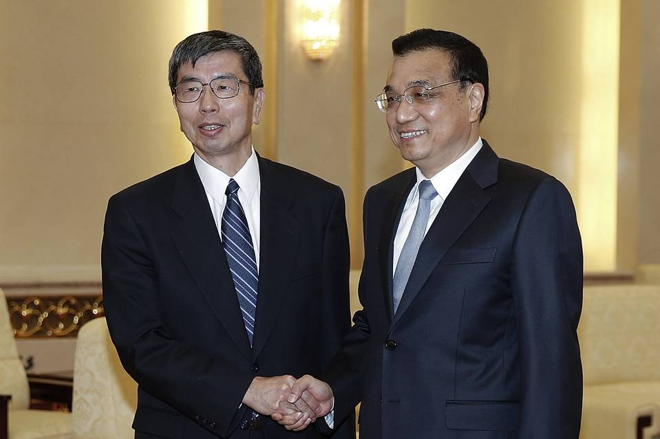 Asian Development Bank President Takehiko Nakao, left, meets with Chinese Premier Li Keqiang in Beijing. Emerging nations, particularly China, say they lack influence over the ADB, the World Bank and the IMF.