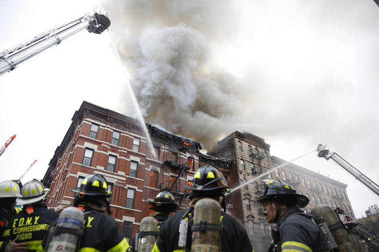 Firefighters at the scene of a building explosion and fire in the East Village.