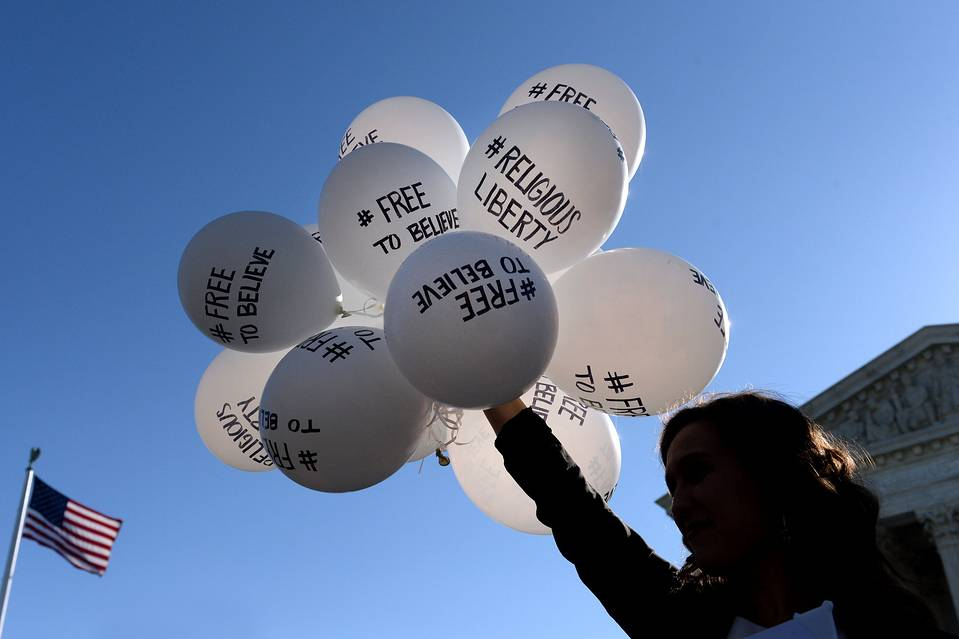 A protestor holds balloons calling for religious freedom outside the U.S. Supreme Court on Tuesday in Washington, D.C.