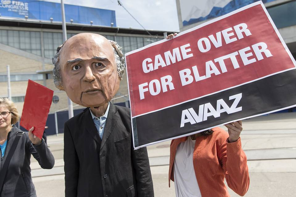 Activists with a mask of FIFA president Sepp Blatter are pictured in front of the Hallenstadion in Zurich where the world soccer body held its congress last week.