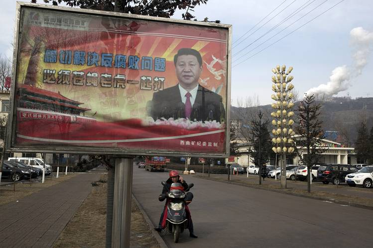 "An anticorruption billboard showing Chinese President Xi Jinping—with the slogan ""to exactly solve the problem of corruption, we must hit both flies and tigers""—in Gujiao, China, in Feb. 2015."