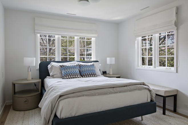 The guest bedroom is in a space that the couple used as a kid's bedroom before the renovation.