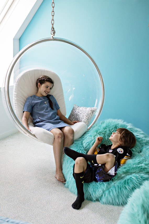 Olivia, shown here with her brother Luke, says she has had as many as six friends at a time on the 'bubble chair' in her room.