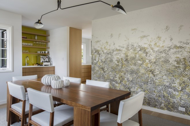 Ms. Byrne chose wallpaper (like the kind shown here in the dining room) to keep the textures interesting without adding too much of an expense.