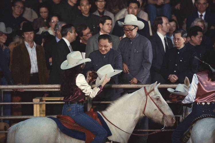 Chinese leader Deng Xiaoping accepts a cowboy hat at a rodeo near Houston, Texas, during a tour of the U.S. in 1979.