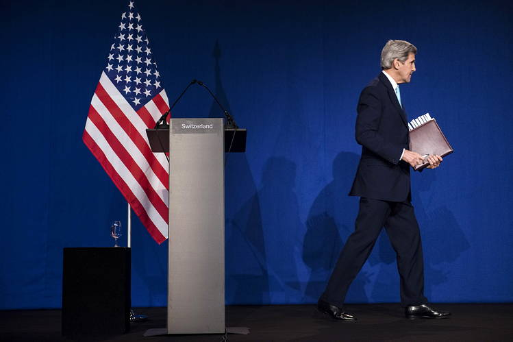 U.S. Secretary of State John Kerry leaves the stage after speaking to the press following Iranian nuclear talks at the Swiss Federal Institute of Technology in Lausanne in April.