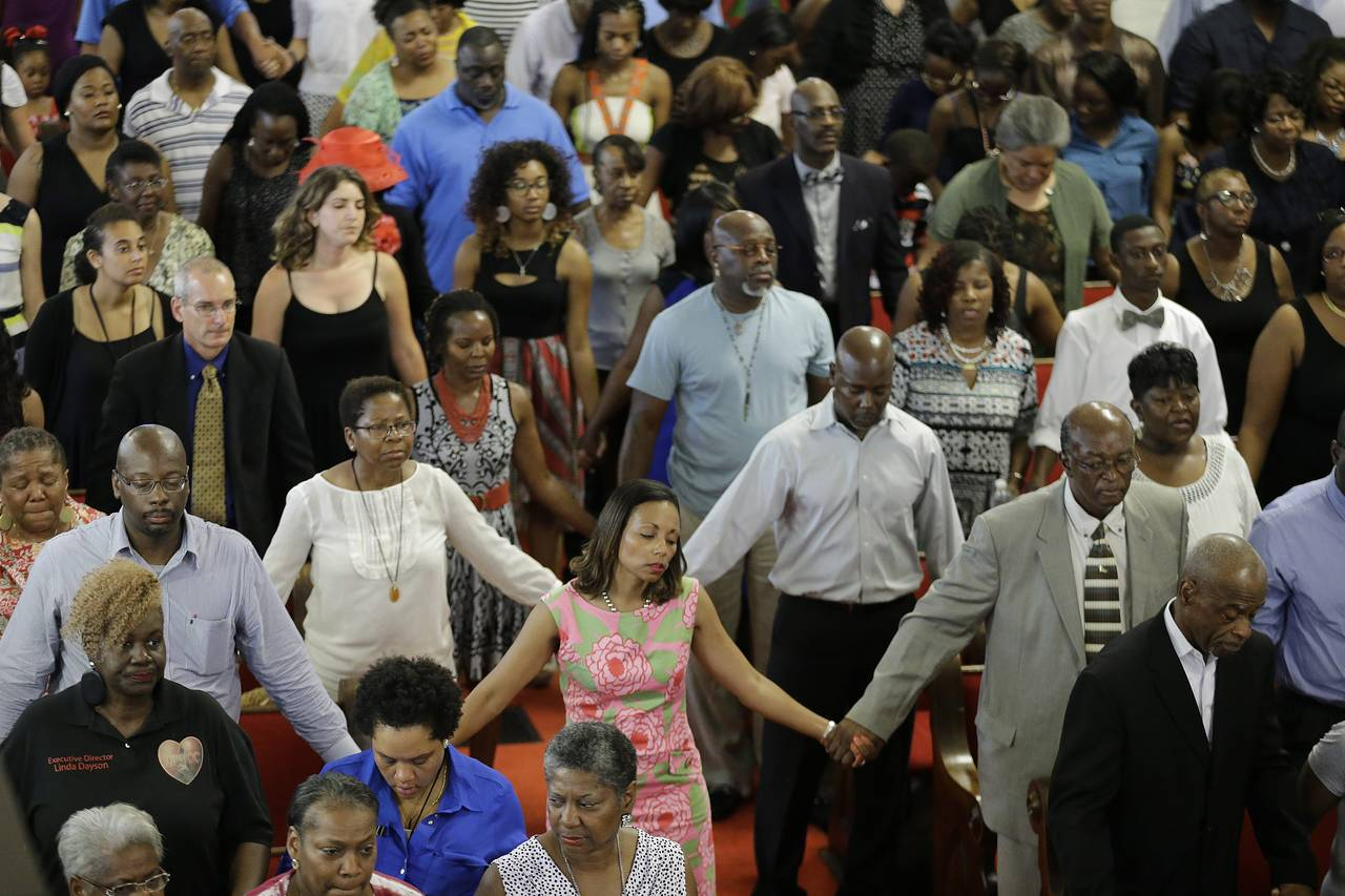 Parishioners sing at the Emanuel A.M.E. Church Sunday.