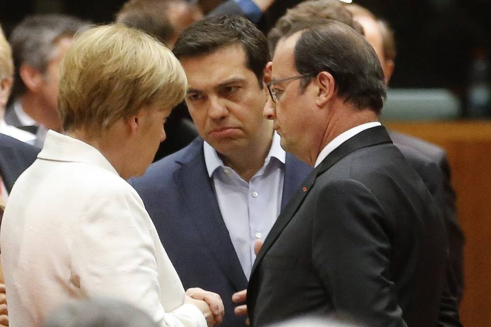 Greek Prime Minister Alexis Tsipras, center, talks with German Chancellor Angela Merkel and French President Francois Hollande at the start of eurozone leaders' summit on the Greek crisis in Brussels on Sunday.