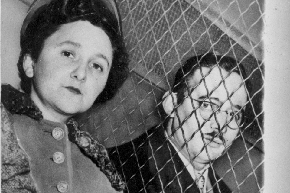 Ethel and Julius Rosenberg are separated by a wire screen as they are transported to Sing Sing Prison following their conviction in New York City in March 1953.