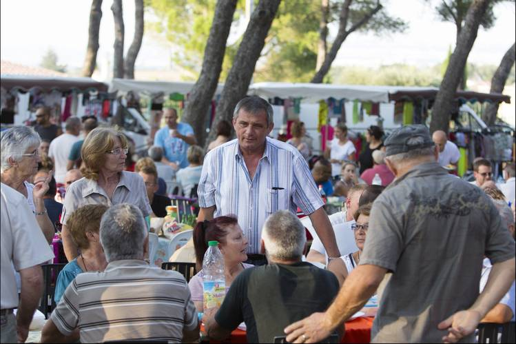 Roland Mouren, center, mayor of cash-strapped Châteauneuf-les-Martigues, France, at a community picnic on Friday.