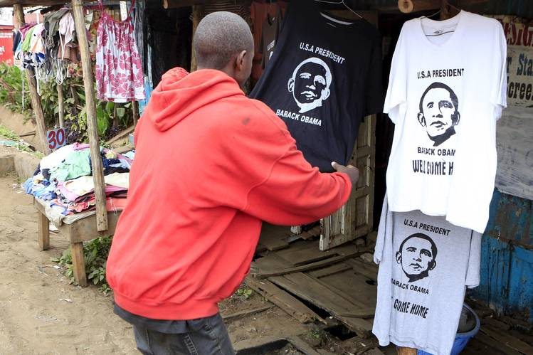 A customer looked at a T-shirt displaying the image of President Barack Obama at a stall in Nairobi's Kibera slum on Thursday, a day before the president's scheduled arrival in Kenya.