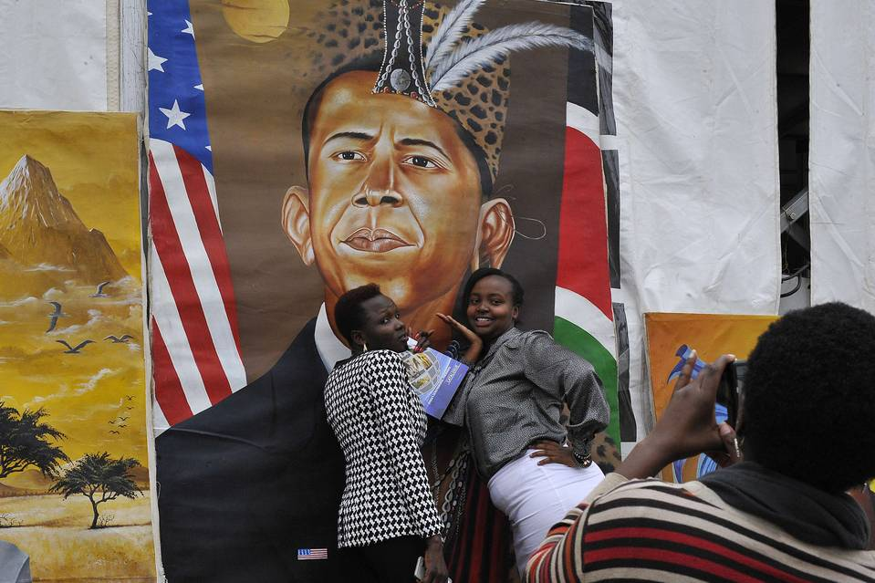 Women in Nairobi posed for a photograph in front of a painting depicting President Barack Obama on Thursday, the eve of the president's arrival in Kenya.