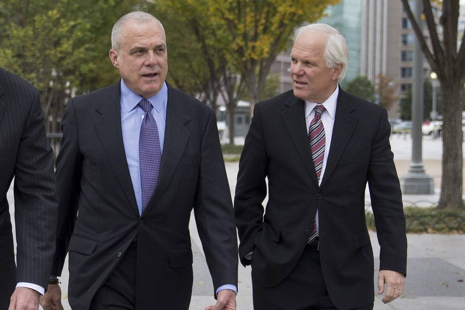 Aetna CEO Mark Bertolini, left, walks with Anthem chief Joseph Swedish.