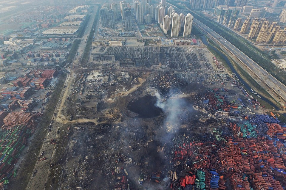 A large hole is seen on the ground in the Chinese port city of Tianjin Saturday. At least 100 people were killed and more than 700 injured in Wednesday's explosions.