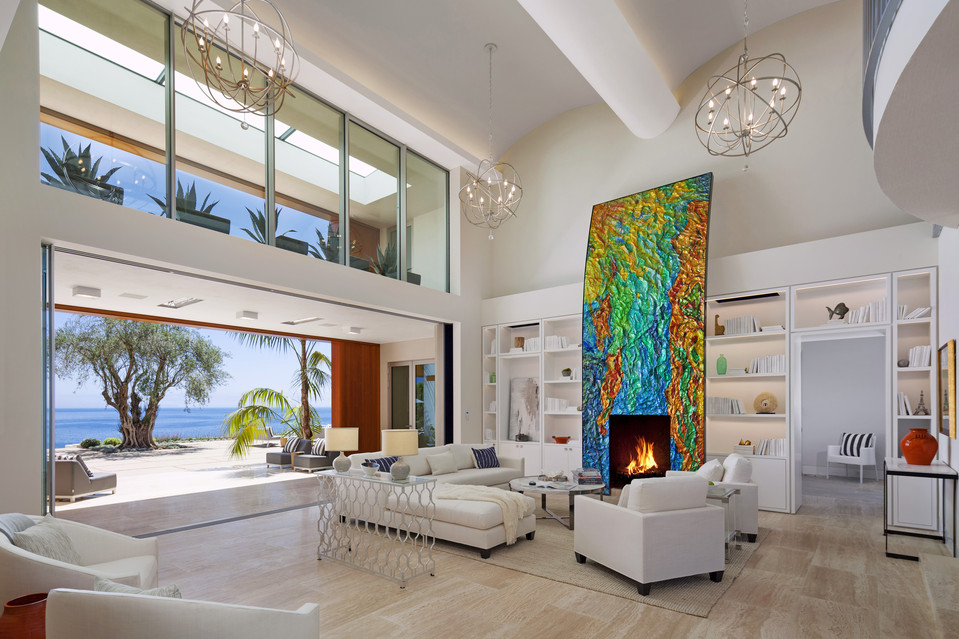 In the living room, the owners commissioned an artist to create the colorful sculpture surrounding the fireplace. Standing nearly 20-feet high, it is intended to be an abstract image of the nearby Channel Islands.