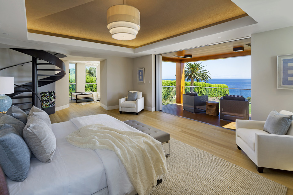 The master bedroom. The staircase leads to a tower topped with an observation deck and an outdoor hot tub.