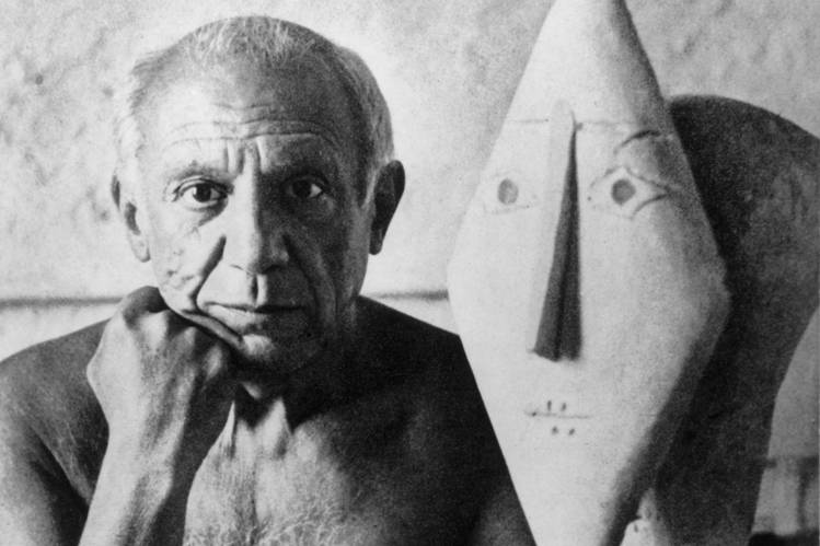 Pablo Picasso, next to one of his sculptures.