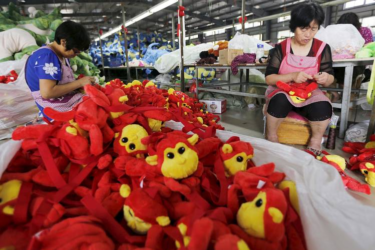 Chinese workers made stuffed dolls for export to Europe and North America at a factory in Lianyungang, Jiangsu province, on Sept. 6.