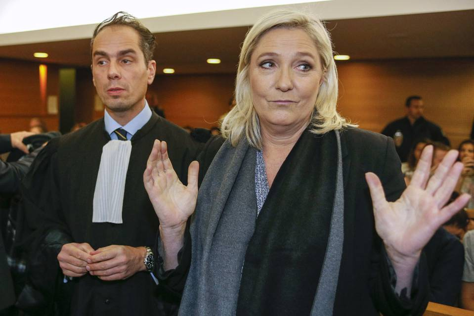 National Front leader Marine Le Pen arrived at a Lyon court with her lawyer Tuesday to face a charge of inciting racial hatred.
