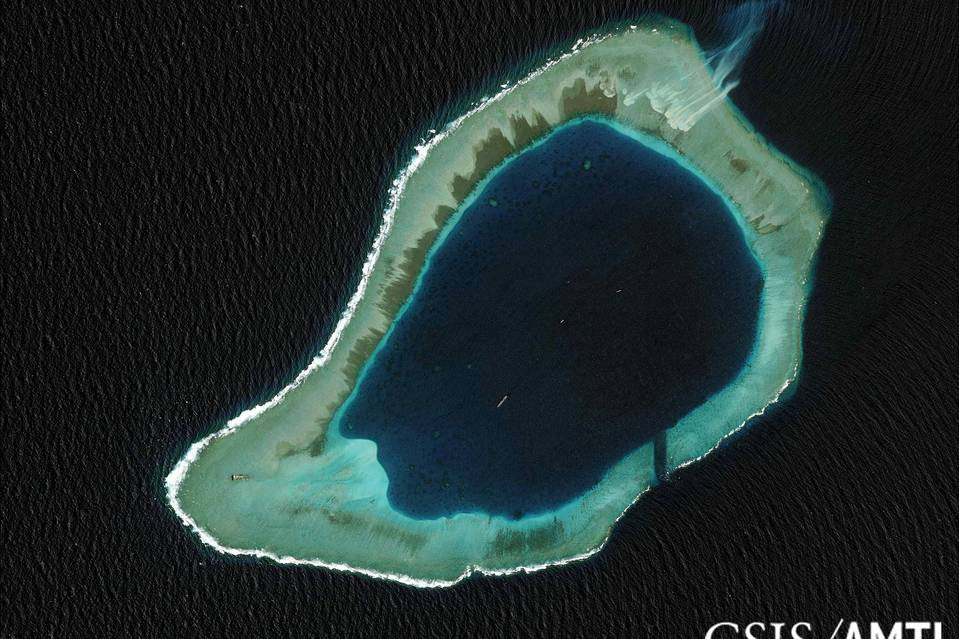 Subi reef, located in the disputed Spratly Islands in the South China Sea, is shown in this handout Center for Strategic and International Studies Asia Maritime Transparency Initiative satellite image taken in 2012, and released to Reuters this week. A U.S. guided-missile destroyer sailed close to it this week.