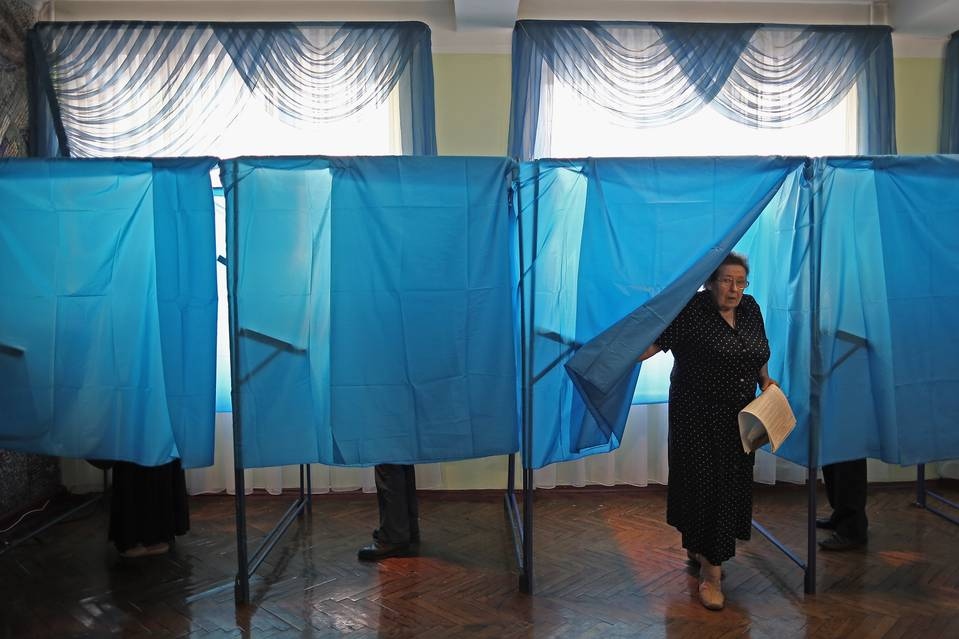 A woman votes in Kiev in May 2014. A cyberattack ahead of Ukraine's 2014 presidential election threatened to derail the vote.