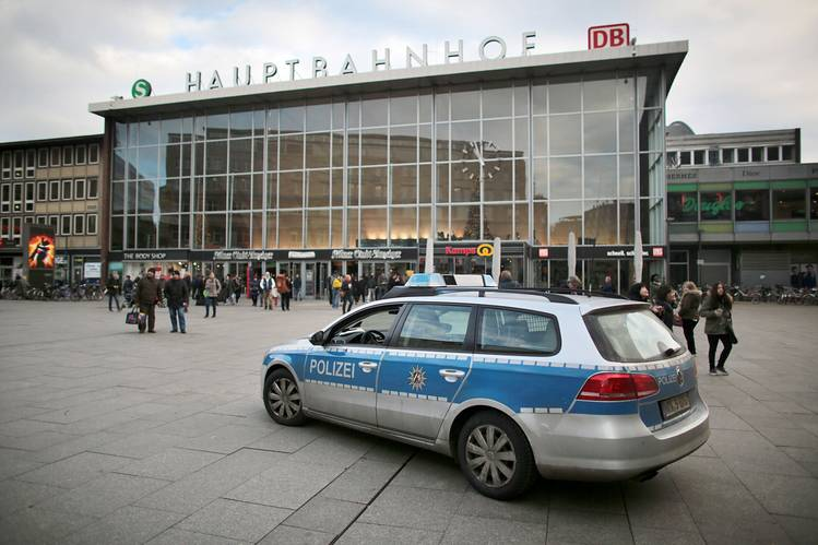 A police car passes the central railway station in Cologne on Tuesday.