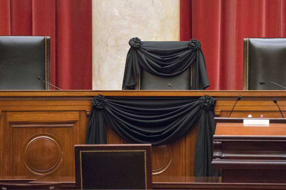 The late Justice Antonin Scalia's Supreme Court chair and the bench in front of it are draped in black wool crepe, in keeping with a tradition dating to 1873.